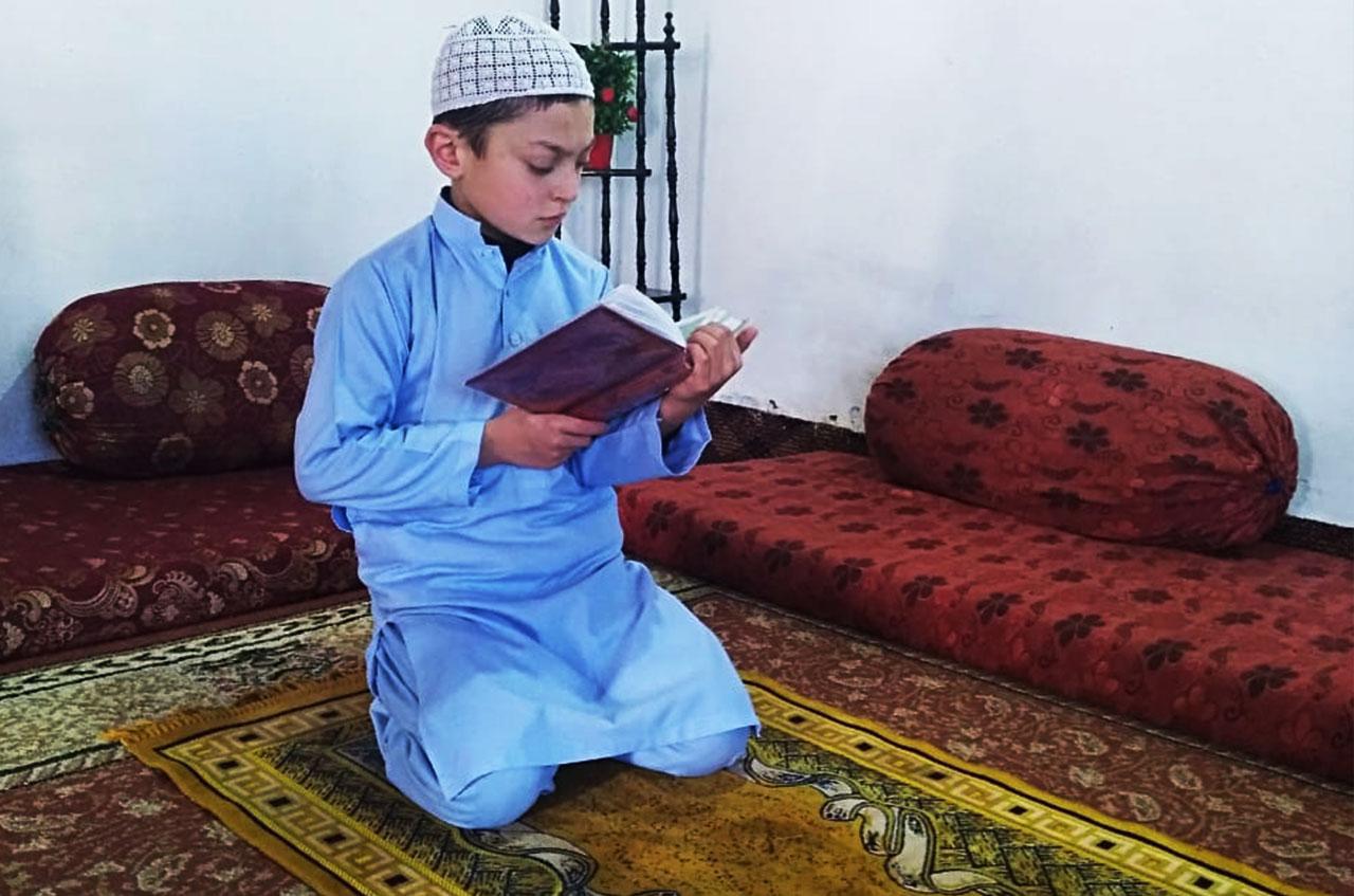 Kid reciting Holy Quran